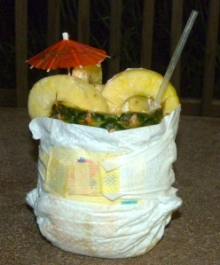 An expensive pineapple drink starts leaking and you fix the problem by putting a diaper on it.  Mom with the save!